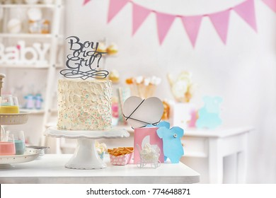 """""""Boy or girl"""" cake for baby shower party on table indoors"""