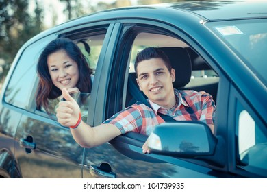Boy and Girl in a Car Leaving for Vacation