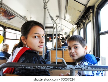 Boy and girl in city bus