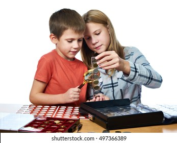 Boy and girl are considering coin collection isolated white