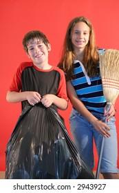 boy & girl doing house keeping chores vertical