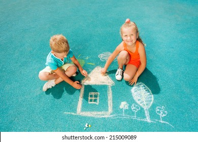 Boy and girl draw chalk image sitting toggether