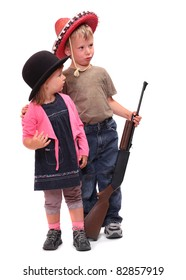 Boy and girl dressed in retro costume from American Old West.