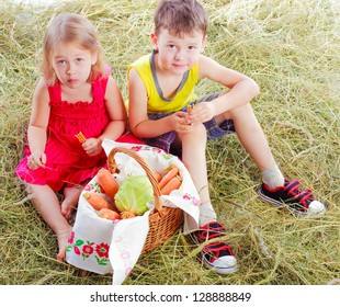 the boy and the girl eat vegetables isolated on a white background