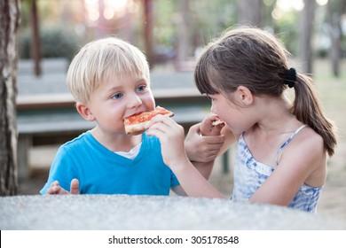 BOY AND GIRL EATING