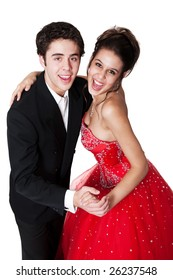 Boy and girl, in formal attire, dancing at their high school prom.