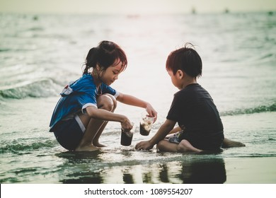 Boy and girl are having fun on Summer beach with sunlight