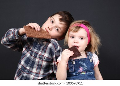 the boy and the girl hold chocolate