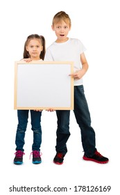 Boy and a girl hold a wooden frame with an empty copyspace, isolated