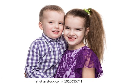 boy and girl hugging on white background, happy smiling family, lifestyle people concept