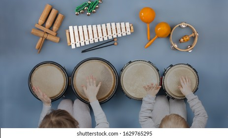 Boy girl kids playing orff instruments - Musical instruments for children: drums, flute, metallophone  - Shutterstock ID 1629765295