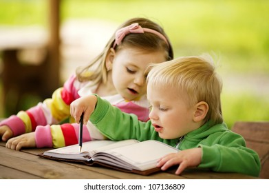 boy and girl learning
