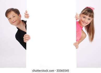 The boy and the girl look because of a white message board