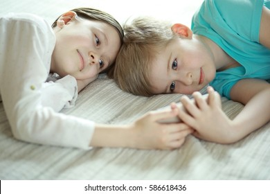 Boy and girl looking at a smart phone