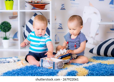 boy and girl on the floor playing with toys