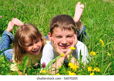 Boy and girl on a green meadow