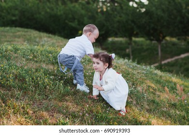 Boy and girl on a hill on the grass
