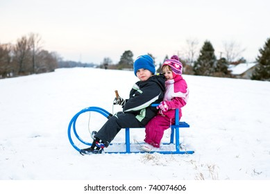 Boy and girl on sledge