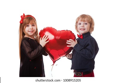 boy and girl on a white background holding a balloon red heart