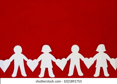 boy and girl paper doll chain with hearts on red background