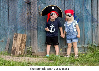 Boy and Girl in Pirate Costume Outdoors. Masquerade Holiday