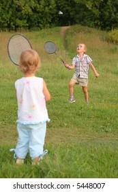 boy and girl play badminton
