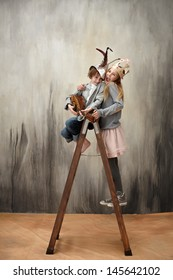 Boy and girl playing arts