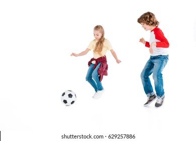 Boy and girl playing football isolated on white, children sport concept