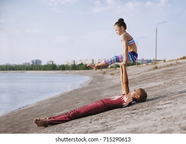 boy and girl professional gymnast outdoor