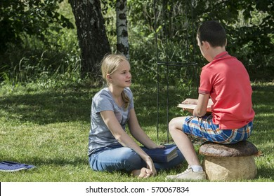 Boy and girl reading the book twelve years in nature.