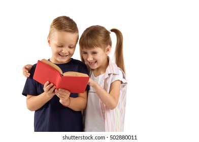 boy and girl schoolchildren. Children holding books in their hands
