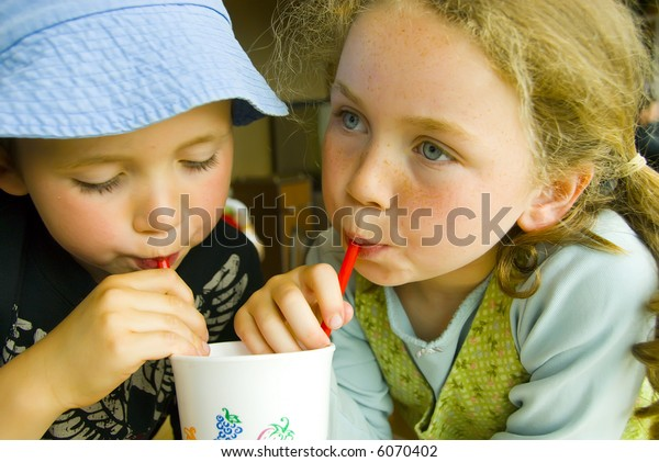 boy and girl sharing a drink