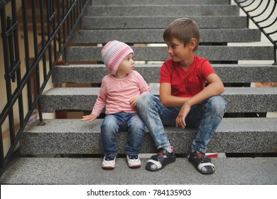 boy and girl sitting on stairway