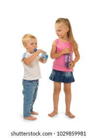 Boy and girl stand side by side, holding a bottle of water isolated on white