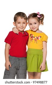 A boy and a girl are standing together; isolated on the white background