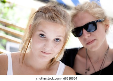 Boy and girl teens looking into camera with a friendly smile