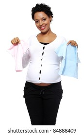 Boy, girl or twins. Pregnant woman holding two bodysuits for a baby (blue and pink)