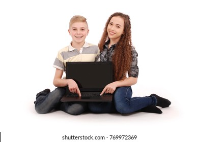 Boy and girl using a laptop isolated on white background