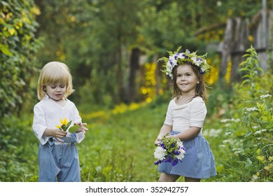 Boy and girl walking in the green garden.