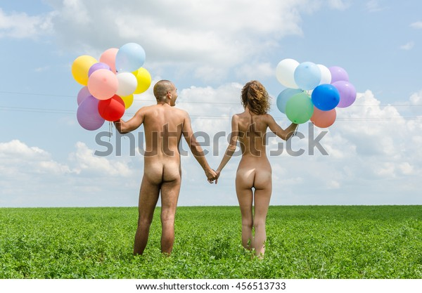 boy and girl walking naked in the meadow