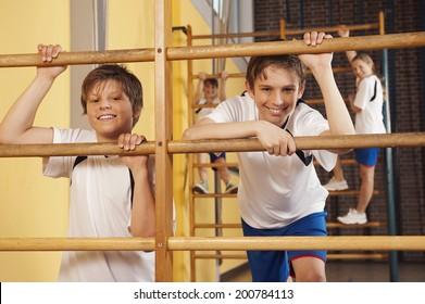 Boy and girls climbing wall bars