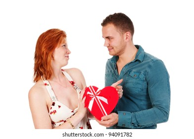 boy gives girl a heart shaped box isolated