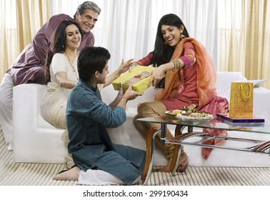 Boy giving a gift to his sister on Rakhi