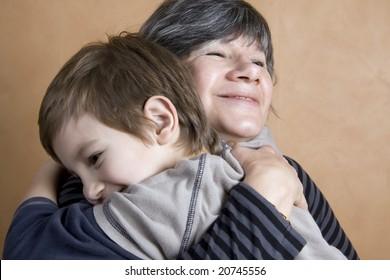 Boy giving his grandmother a huge hug