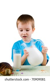 Boy with  a glass of milk on a white background