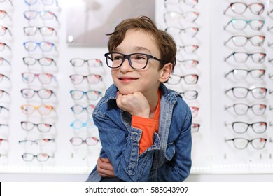 boy in glasses , at optics store
