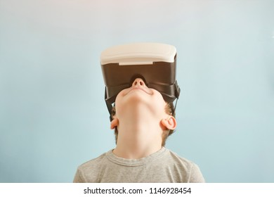 Boy with glasses of virtual reality. Blue background