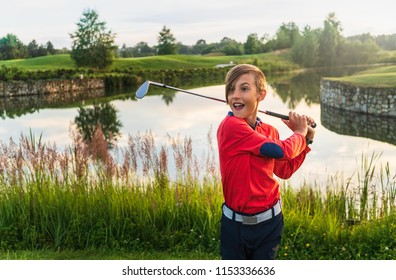 Boy golf player expressing emotions after succesful shoot at golf course