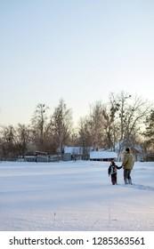 Boy and grandfather enjoying the snow. Happy boy grandpa have winter fun