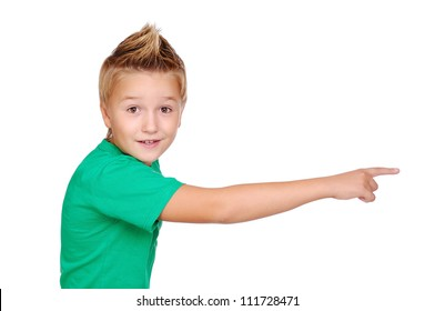 Boy in  green tshirt pointing with his fibger